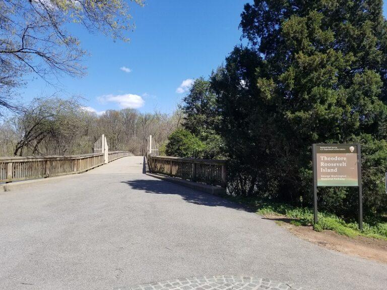 TRI NPS sign at bridge to park